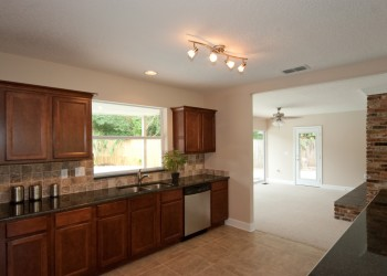 Image of a kitchen looking into a living room