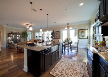 Wide angle of a kitchen looking into a living and dining room